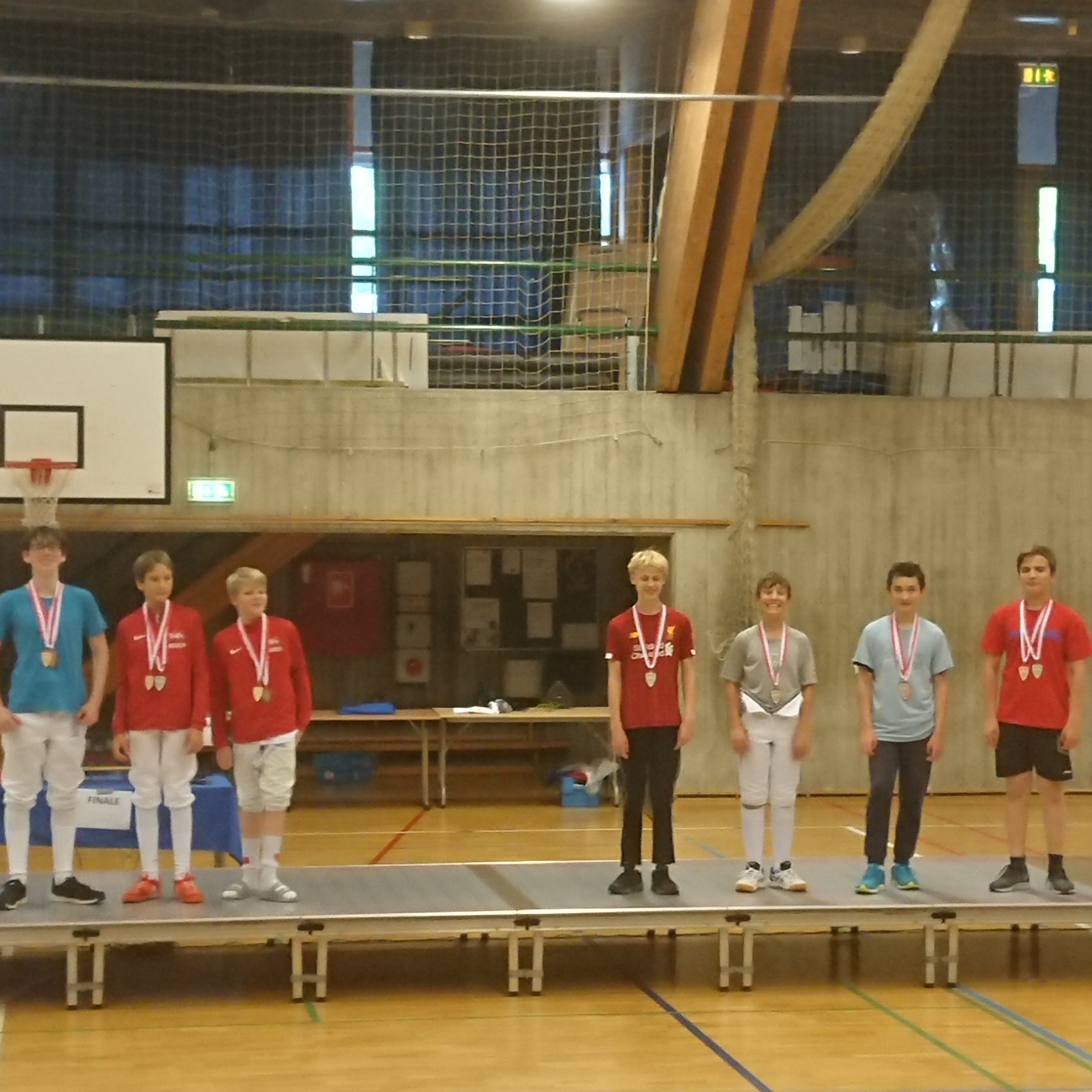 Sejrspodie med guld- og sølvvindere.